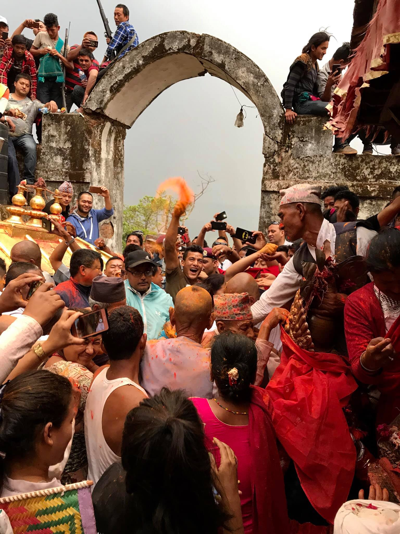 A Devotee Scattering Vermillion Powder in Sindure Jatra