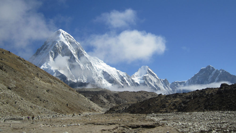 Walking above Gorakshep towards Kalapattar- Mt. Pumori on the view