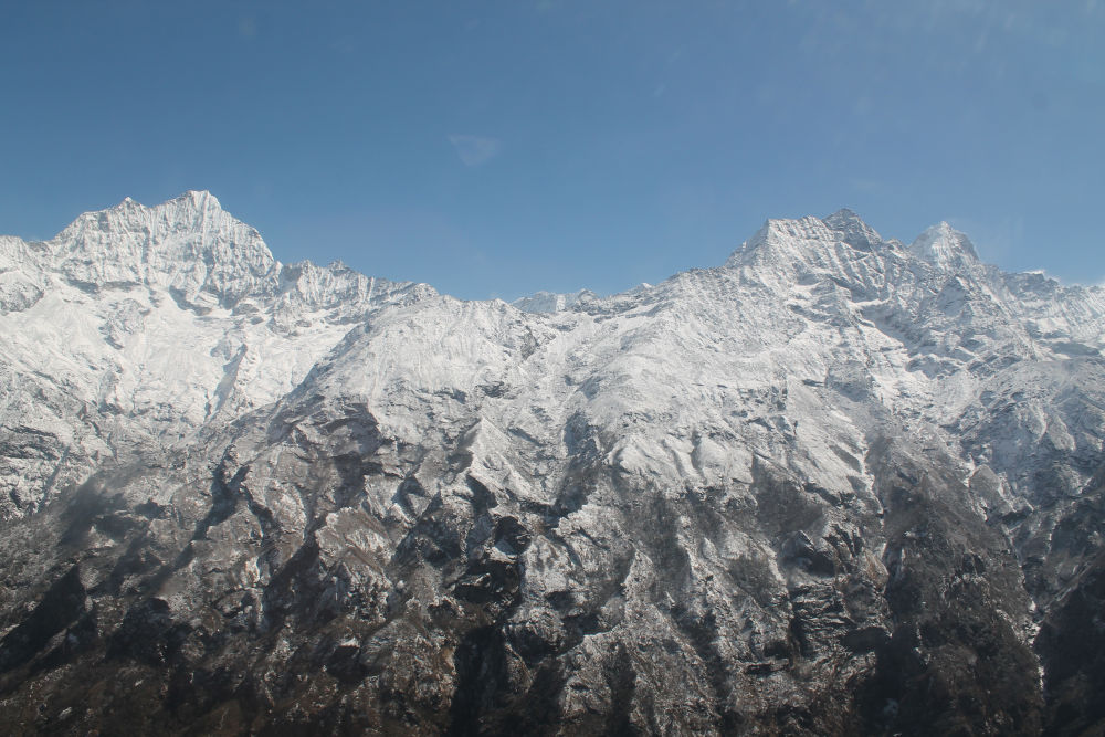 Amazing blend of soft white snow and black hard rocks - heli tour to Everest