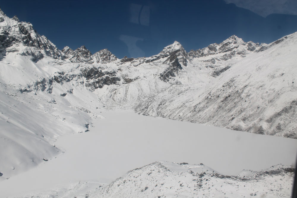Aerial view of Frozen glacial lakes of Gokyo Everest