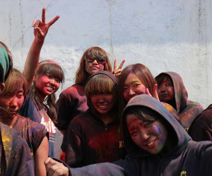 Japanese students enjoying Holi