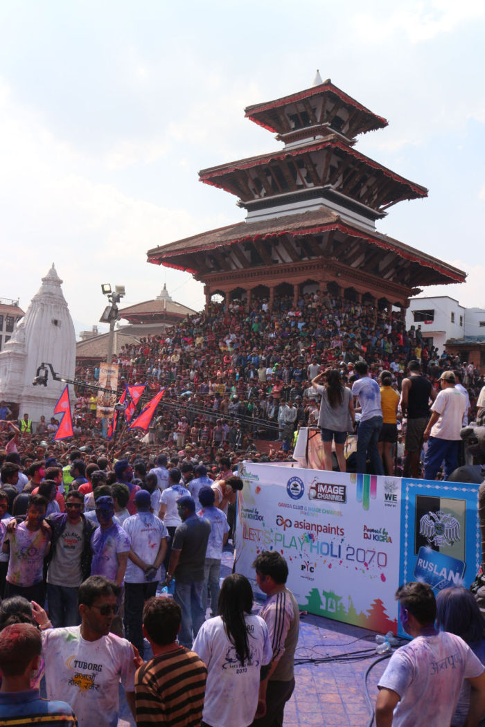 Triangular Nepalese flags rises in the mass at Basatanpur during Holi festival