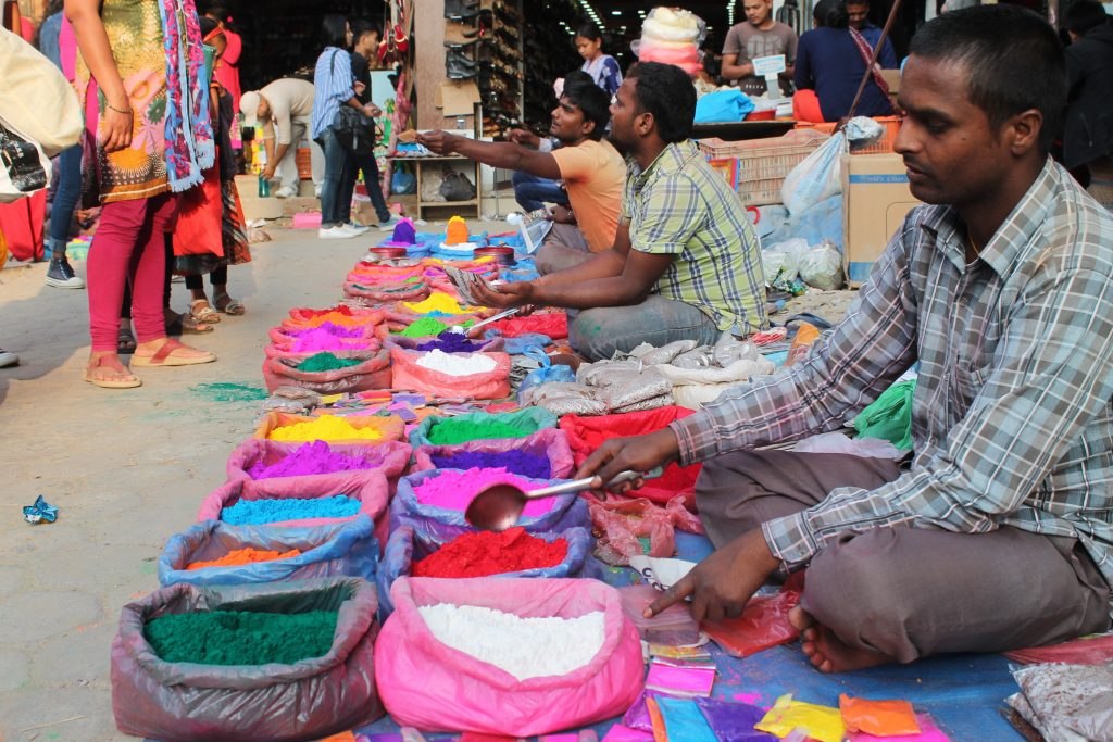 Vendors selling varieties of colours (used for Bhai Tika and Rangoli decaoration) at Ganesthan, Chabahil