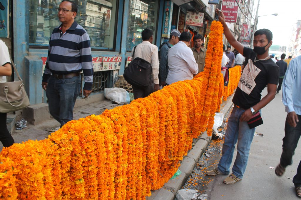 Array of Marigold garlands at public footpath in New Road