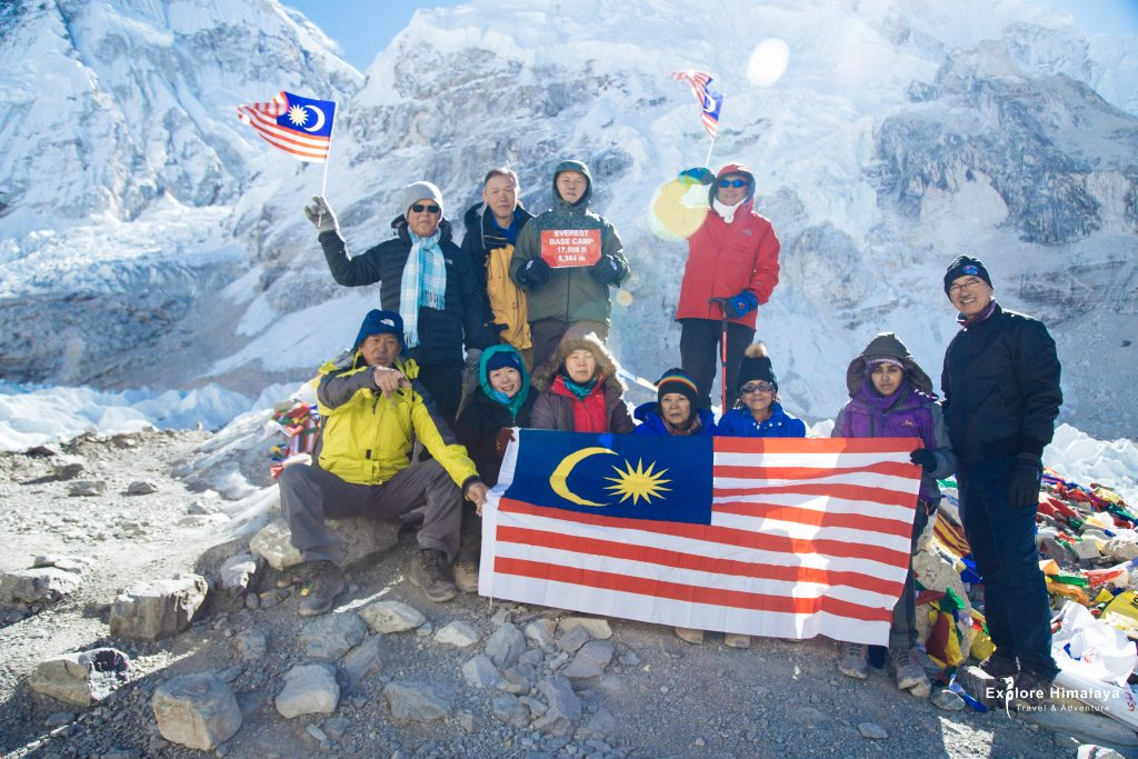 Malaysian Trekkers with their national flag at Everest Base Camp