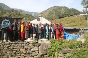 Villagers standing in a queue for eye check up in Katike