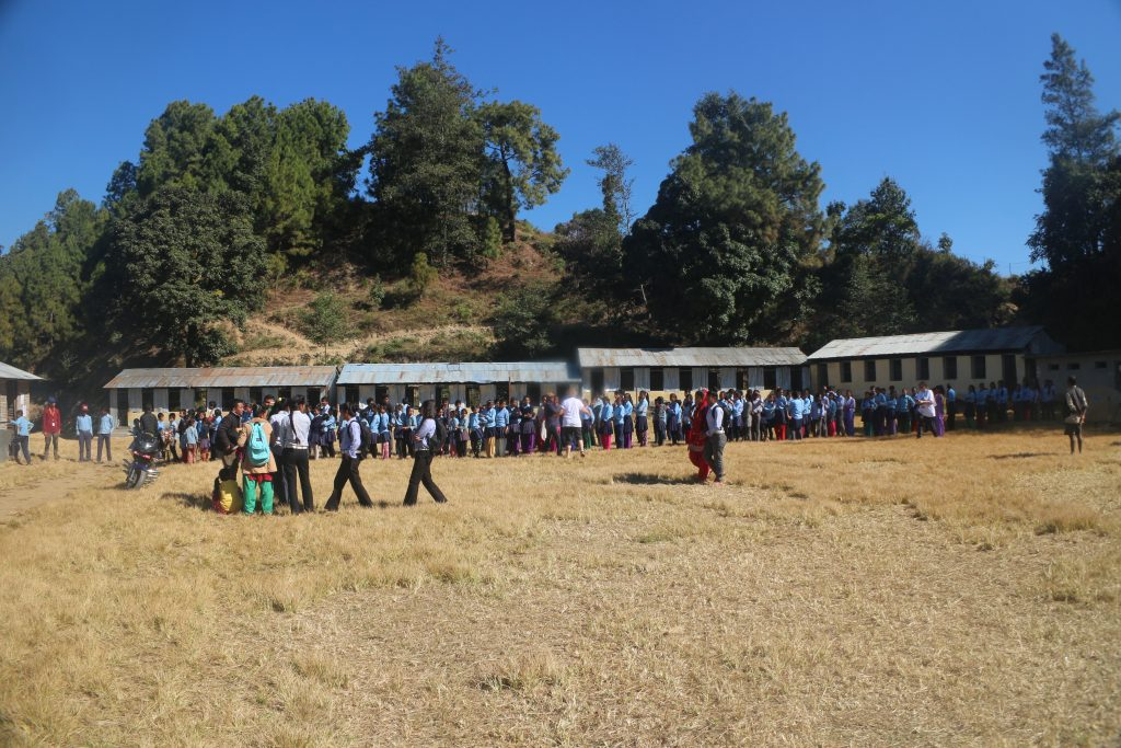 Students in a queue for eye check up at Aiselu Kharka School