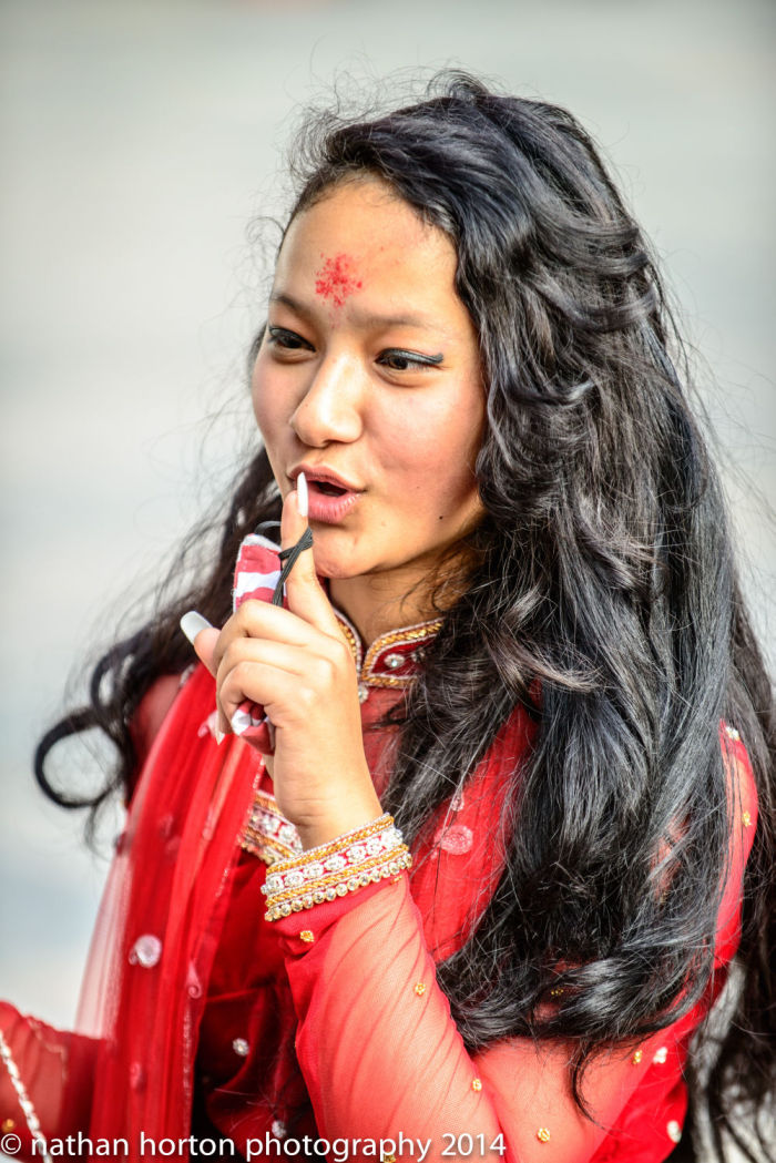 Everyone loves to see a young Nepali girl in red attire