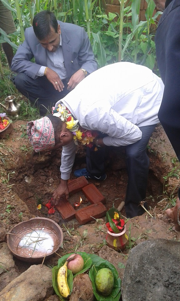 Director General of Department of Archeology Mr. Bhes Narayan Dahal planting the first brick of Nuwakot Heritage Village Project