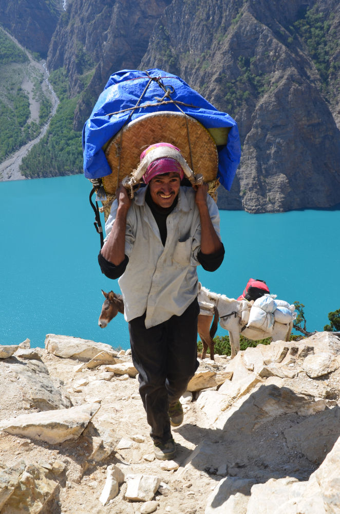 Smile with a heavy load on the head- Happy Dolpo - The Most beautiful people on Earth