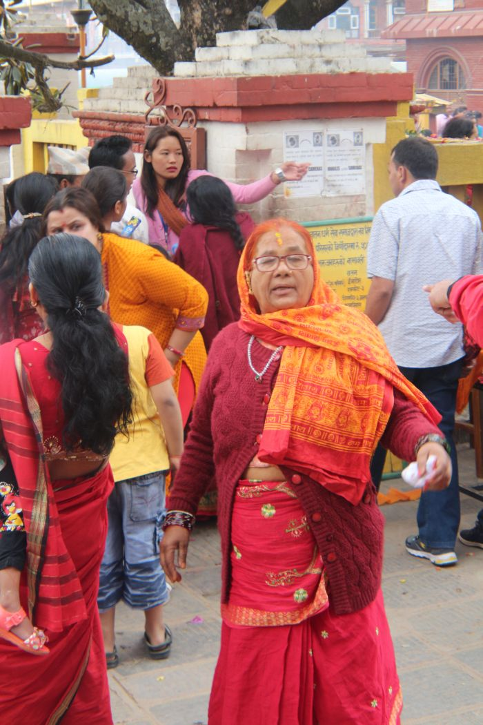 One common thing in Hindu temples- Ladies in red attires