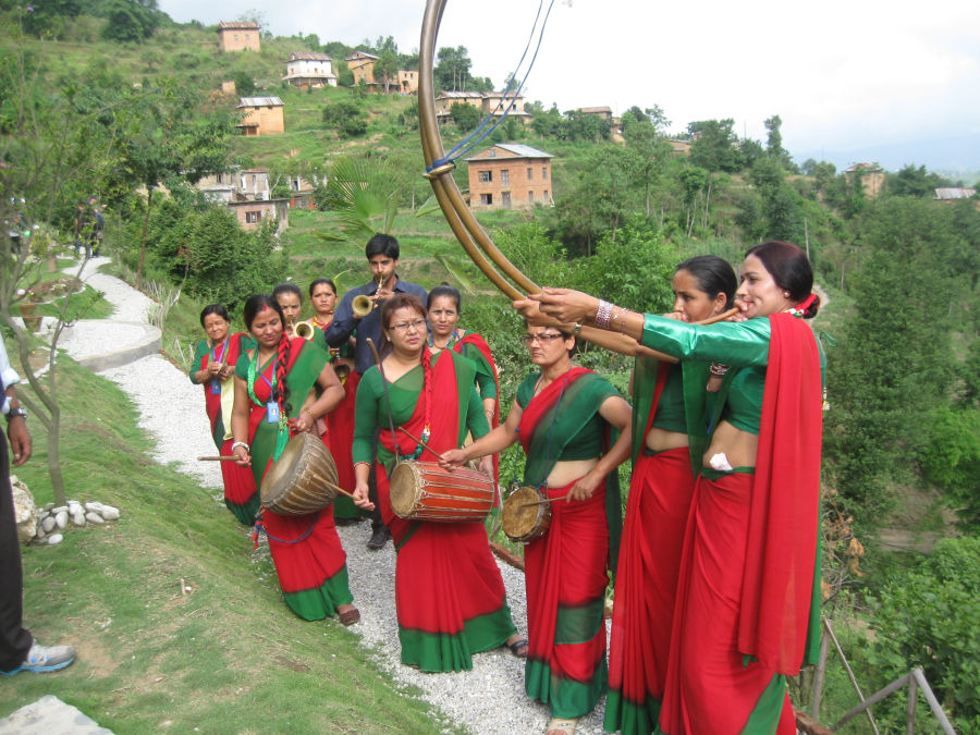 Ropai festival - Ladies in red and green attire playing traditional musical instruments
