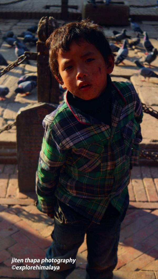 Kids in Patan love to play with the pigeons