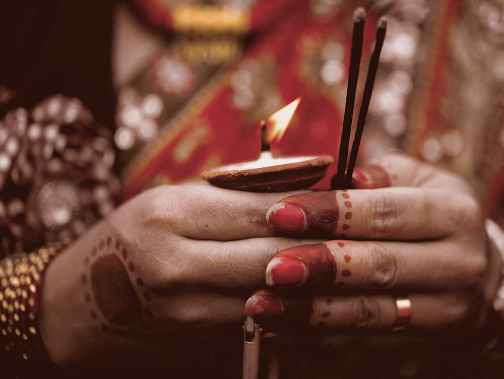 Colorful hands of a devotee on Teej