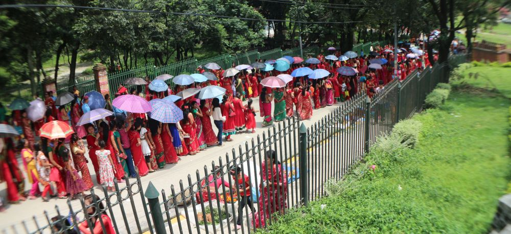 Colorful umbrellas but same red saree - Teej festival in Nepal