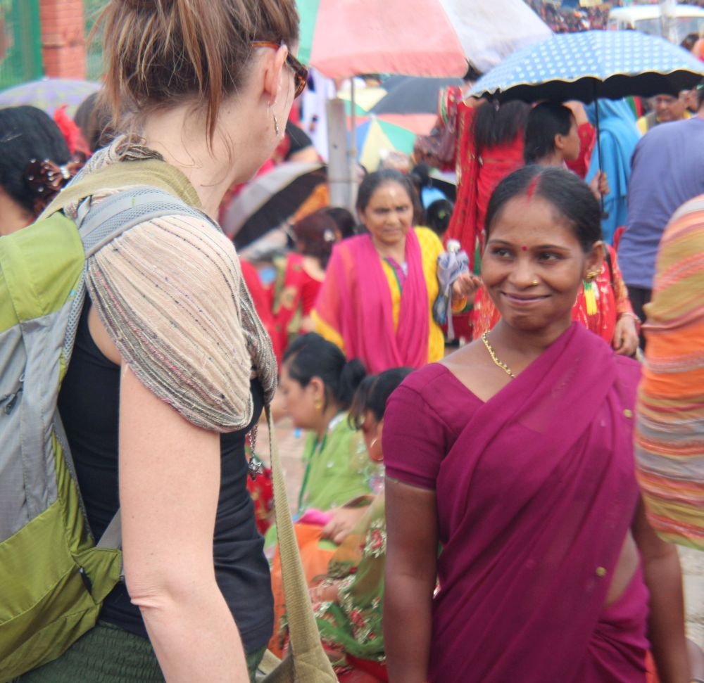 Hindu lady smiles at a foreign lady at Pashupatinath during teej